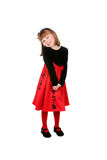 Pretty little girl in red dress and tights. Pretty little girl standing in red dress and tights Royalty Free Stock Photos