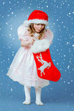 Pretty little girl in red hat Royalty Free Stock Images