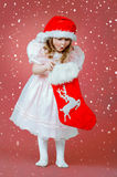 Pretty little girl in red hat Stock Photo