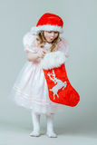 Pretty little girl in red hat Stock Photography
