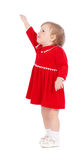 Pretty little girl in a red short dress Royalty Free Stock Photos