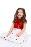 Pretty little girl in red and white dress. Pretty little girl in red and white christmas or valentine's day dress Royalty Free Stock Images
