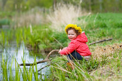 Pretty little girl relax at beauty summer landscape background Stock Images