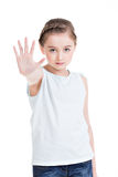 Pretty little girl requiring stop with her hand. Pretty little girl requiring stop with her hand - isolated on white Stock Image