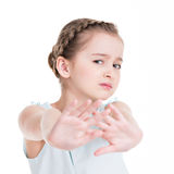 Pretty little girl requiring stop with her hand. Royalty Free Stock Images