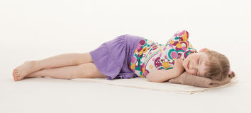 Pretty little girl resting on the floor Stock Images
