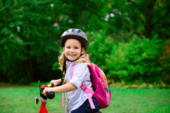 Pretty little girl ride with bicycle Royalty Free Stock Photography