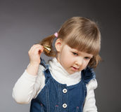Pretty little girl ringing with bells Royalty Free Stock Photos