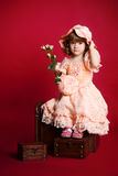 Pretty little girl with rose flower and hat Royalty Free Stock Photo