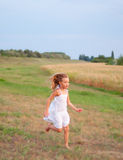 Cute girl running Royalty Free Stock Photo