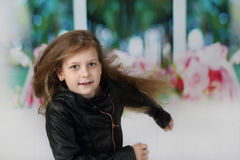 Pretty little girl runs forward. Pretty little girl with long flying hair runs forward to point of view Royalty Free Stock Image