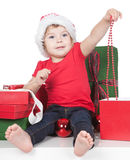 Pretty little girl in santa helper hat over white Stock Photography