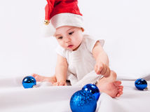 Pretty little girl  in Santas hat Stock Photo