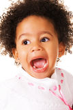 Pretty little girl screaming. Close-up portrait of an expressive little girl Stock Image