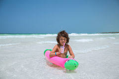 Pretty little girl siting in air- inflated tubes a Stock Images