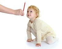 Pretty little girl sees her pencil that shows mom Royalty Free Stock Photography