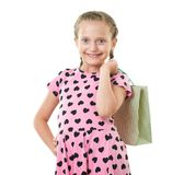 Pretty little girl with shopping bag, studio portrait, dressed in pink with heart shapes, white background Stock Images