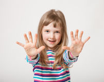Pretty little girl showing her palms Royalty Free Stock Photography