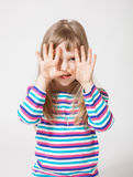 Pretty little girl showing her palms Royalty Free Stock Image