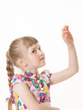 Pretty little girl showing an indefinite gesture Royalty Free Stock Image