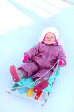 Pretty little girl sit on sled (sleigh). Stock Photography