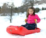 Pretty little girl with ski suit with the bob Stock Photography