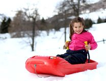 Pretty little girl with ski suit with the bob Royalty Free Stock Images