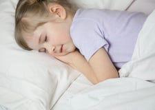 Pretty little girl sleepping Stock Photo