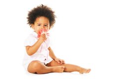 Pretty little girl smelling a flower Royalty Free Stock Photography