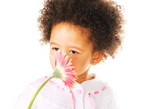 Pretty little girl smelling a flower royalty free stock photos