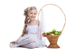 Pretty little girl smile with fruits isolated Royalty Free Stock Image