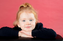 Pretty little girl smiling. Little redhead girl with blue eyes looking at camera and smiling Stock Photography