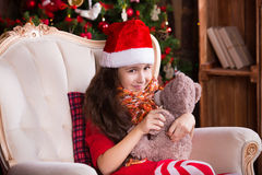 Pretty little girl smiling with teddy bear near Stock Image