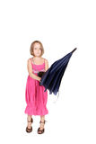 Pretty little girl standing. Holding a blue umbrella Royalty Free Stock Photography