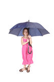 Pretty little girl standing. Holding a blue umbrella Stock Photos