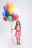 Pretty little girl standing with balloons Royalty Free Stock Photo