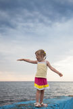Pretty little girl standing on the embankment Royalty Free Stock Photos