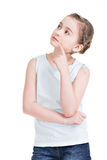Pretty little girl standing and looking up. Royalty Free Stock Photography