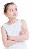 Pretty little girl standing and looking up. Royalty Free Stock Images