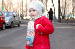 Pretty little girl on the street. Royalty Free Stock Photos