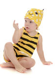 Pretty little girl in a striped suit bee sitting Royalty Free Stock Images