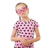 Pretty little girl studio portrait, dressed in pink with heart shapes, white background Stock Photo