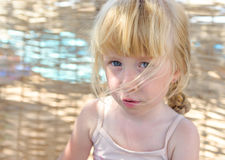 Pretty little girl with a sulky expression Royalty Free Stock Image