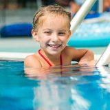 Pretty little girl in swimming... Stock Image