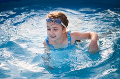 Pretty little girl in swimming pool Royalty Free Stock Photo