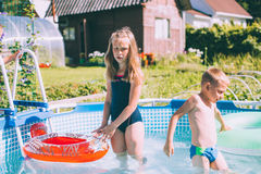 Pretty little girl in swimming pool Royalty Free Stock Images