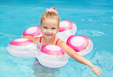 Pretty little girl in swimming pool Royalty Free Stock Photos