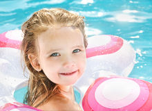 Pretty little girl in swimming pool Stock Photos
