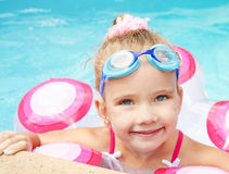 Pretty little girl in swimming pool Royalty Free Stock Image