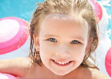 Pretty little girl in swimming pool Stock Image